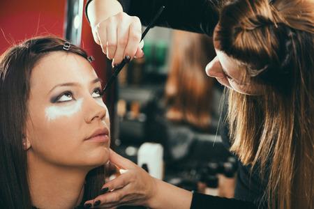 eye service: Eye shadows, make-up, beauty salon, make-up artist, toned image Stock Photo