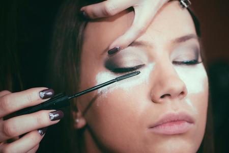 eye service: Masquara, make-up, beauty salon, make-up artist, toned image Stock Photo
