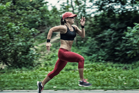 panning: Panning image of attractive female athlete running in the park
