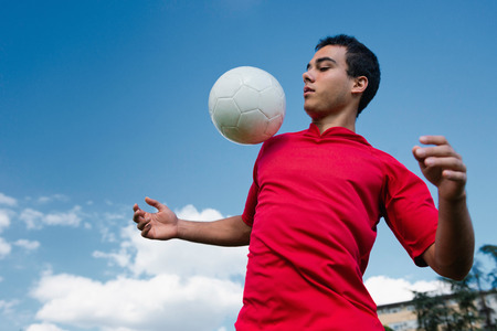 recreational pursuits: Soccer player handling the ball