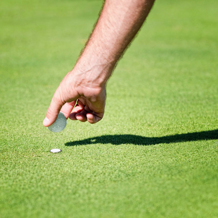 by placing: Placing golf ball on the green