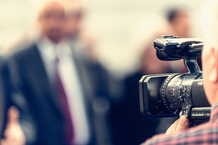 Cameraman recording conference 版權商用圖片