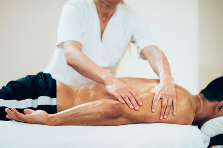 Sports massage - Arm massage - Physical therapist doing massage of arms. Toned image, selective focus set on hands.