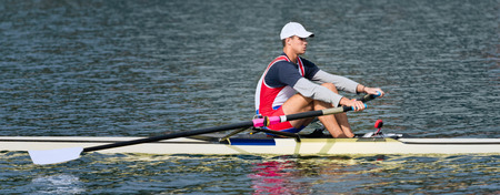 sculling: Single scull rowing - considered as most important discipline in competitive rowing and one of the oldest   sports. Stock Photo