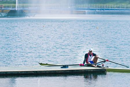 sculling: Scull rowing athlete having a break