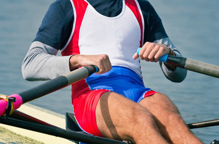 sculling: Sports rowing athlete in action
