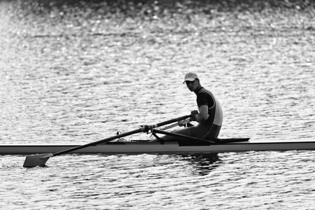 sculling: Sportsman resting after rowing single scull race
