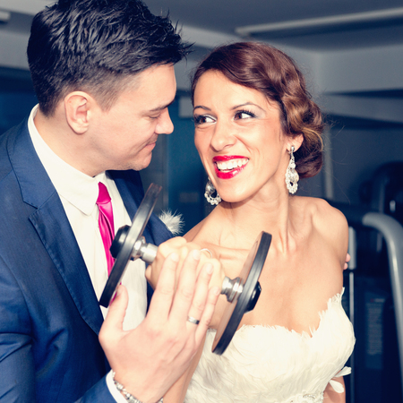 dress suit: Loving portrait of a newlywed couple at the gym. Real story, real people.