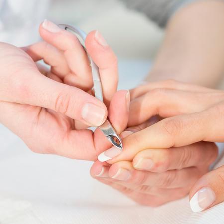 nipper: Nipping cuticles at nail salon