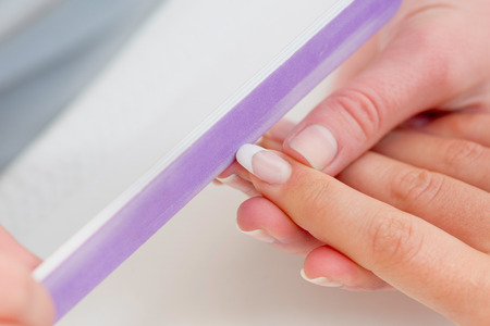 nail file: Manicuring hands - using nail file