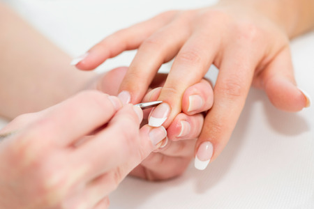 cuticle pusher: Manicure procedure, pushing cuticles at nail salon