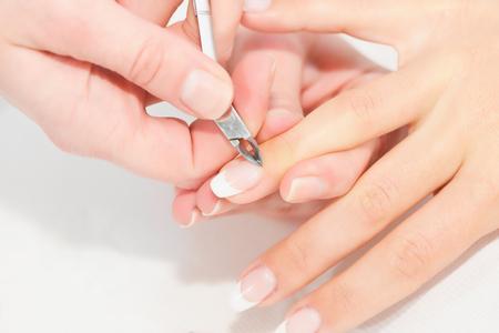 nipper: Nipping cuticles in nail salon Stock Photo