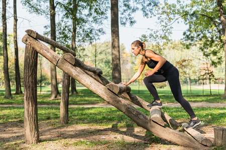 obstacle course: Female athlete training on obstacle course Stock Photo