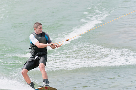 wakeboarding: Young man wakeboarding Stock Photo