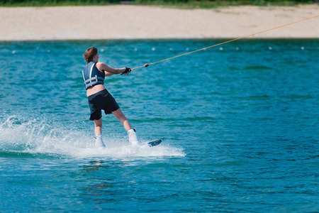 wakeboarding: Cool girl wakeboarding on a lake