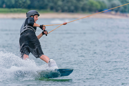 one person only: Cool wakeboarder at high speed