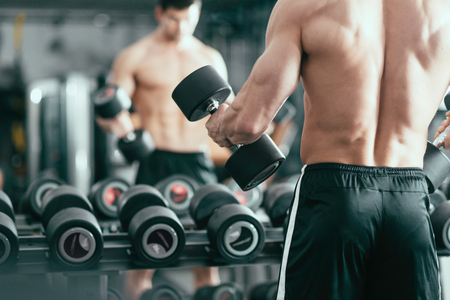 body built: Muscular body builder exercising in the gym Stock Photo