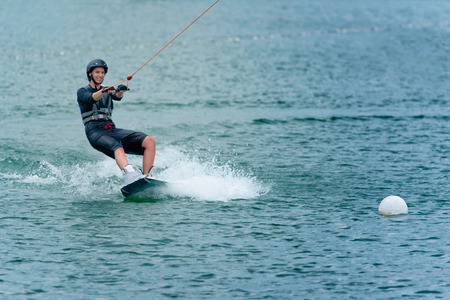 wakeboarding: Young woman wakeboarding on lake