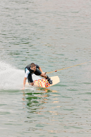 boarder: Wake boarder at high speed, convenient copy space Stock Photo