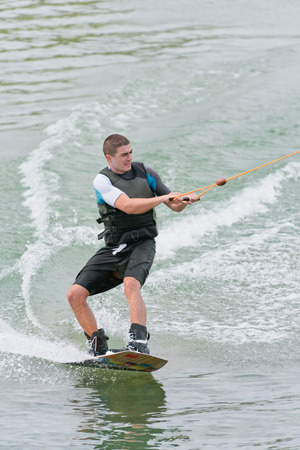 wakeboarding: Young man wakeboarding on lake
