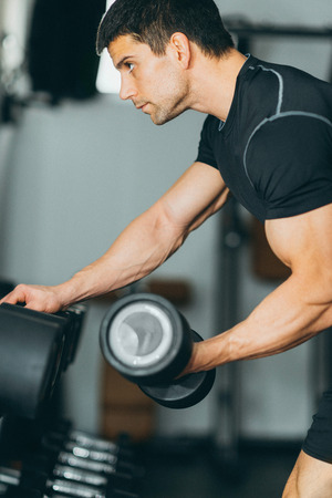 body building: Body building exercise in the gym