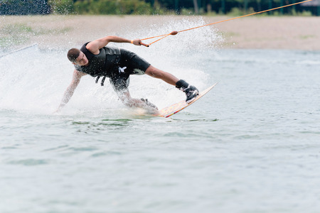 wakeboarding: Young man wakeboarding by the beach