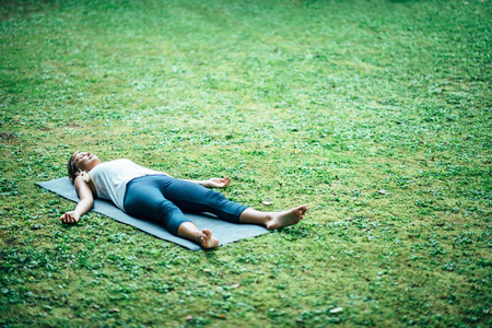 Girl doing yoga, meditating, corpse position