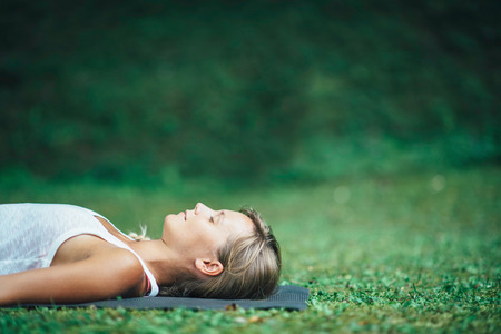 corpse: Girl doing yoga, meditating, Shavasana or corpse position