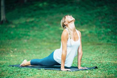 bhujangasana: Girl doing Yoga, Bhujangasana or Cobra Position