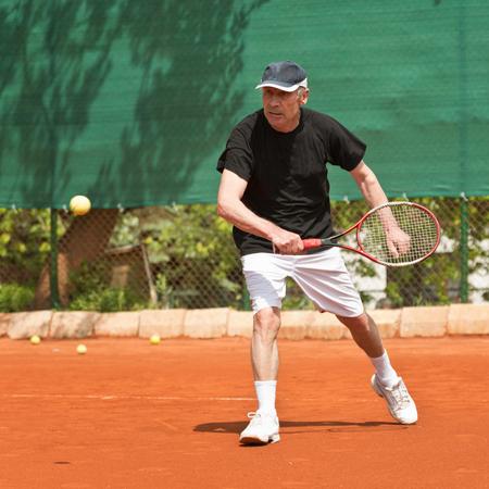 70s tennis: Active senior man, playing tennis