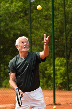 70s tennis: Active senior man playing tennis