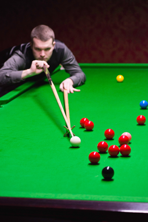 addressing: Snooker player addressing red ball