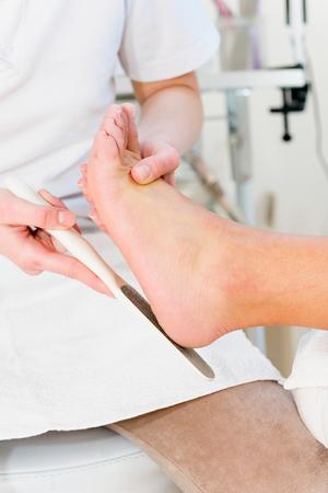 scrubbing: Scrubbing heels, pedicure treatment in beauty salon