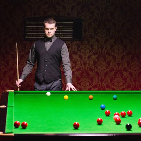 snooker hall: Pool hustler over table