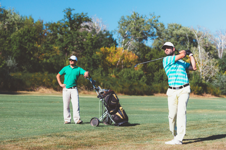 two persons only: Two golfers during the game