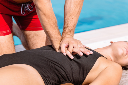 compressions: Lifeguard rescue procedure - doing CPR compressions