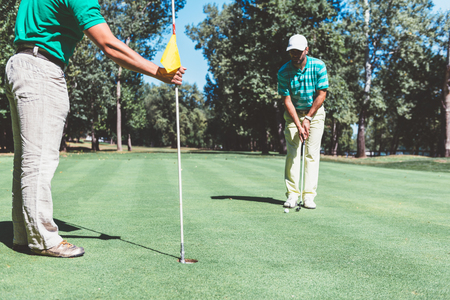 two persons only: Two friends playing golf