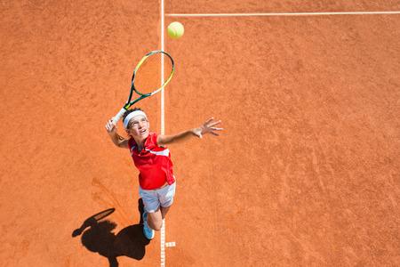 Female tennis player serving. Focus on face, convenient copy space
