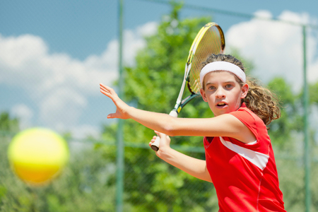 forehand: Young tennis champion, hitting forehand