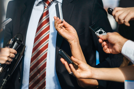 prime adult: Journalists interviewing politician Stock Photo