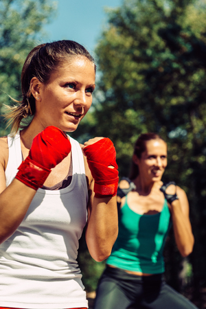 two persons only: Young women in TaeBo training Stock Photo