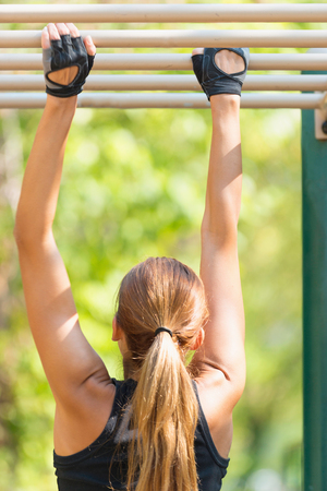 only mid adult women: Monkey bar exercise in a park Stock Photo