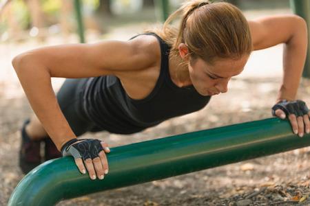 pushups: Young female athlete doing push-ups