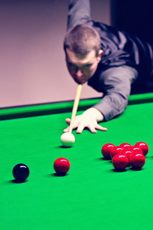 toned image: Snooker competition. Toned image
