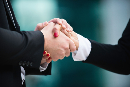 cordial: Cordial business handshake close-up
