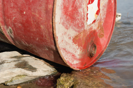 chemical substance: Chemical substance leaking into the water from discarded barrel