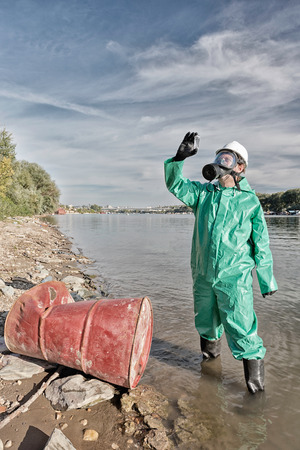 environmentalist: Environmentalist examining collected sample of polluted water Stock Photo
