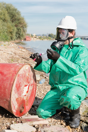 environmentalist: Environmentalist working on a chemical pollution site Stock Photo