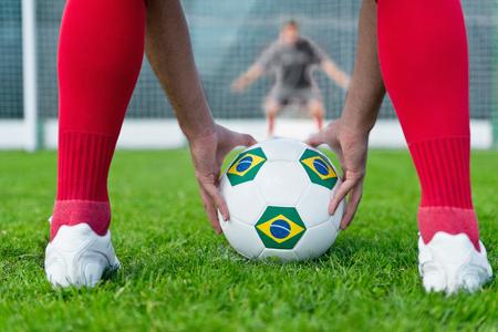 penalty flag: Penalty shootout - striker placing Brazilian ball on a penalty spot