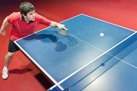 action shot: Table tennis player in action, shot from above
